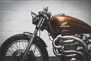 brown custom honda motorcycle