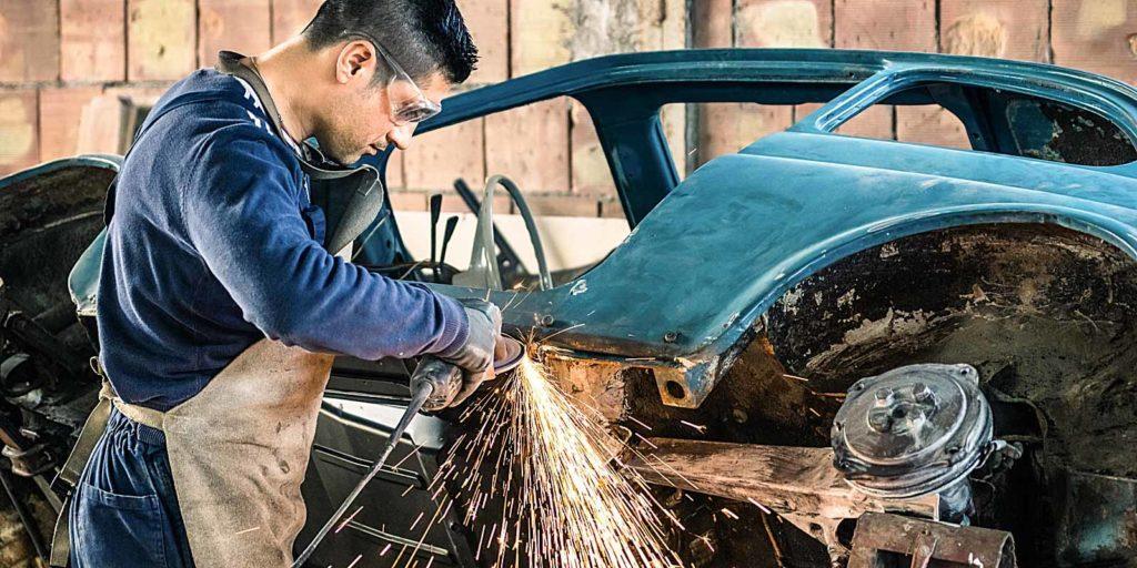 worker-demonstrating-car-restoration-101