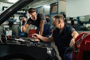 Mechanics working on engines swaps