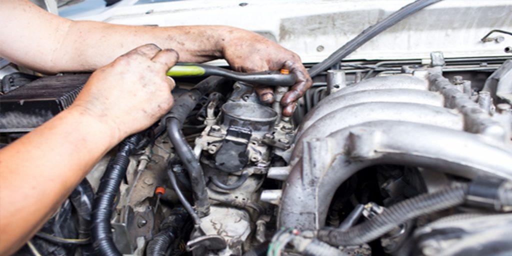 Guy repairing car