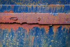 rusted and weathered surface of a truck that needs restoration
