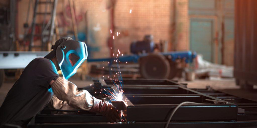 a Welder restoring a truck frame.
