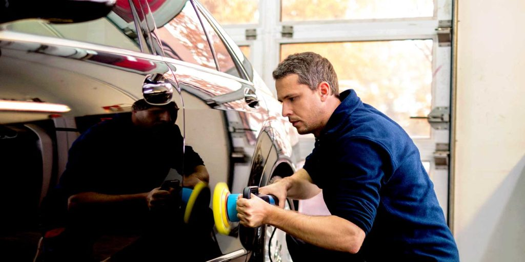 man working on a car restoration after learning where to start.jpg