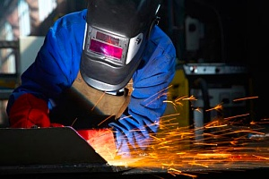a person welding metal to his truck frame