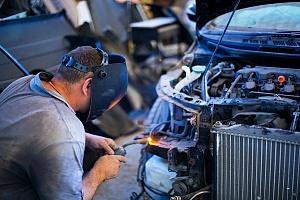man working in shop on a custom auto body