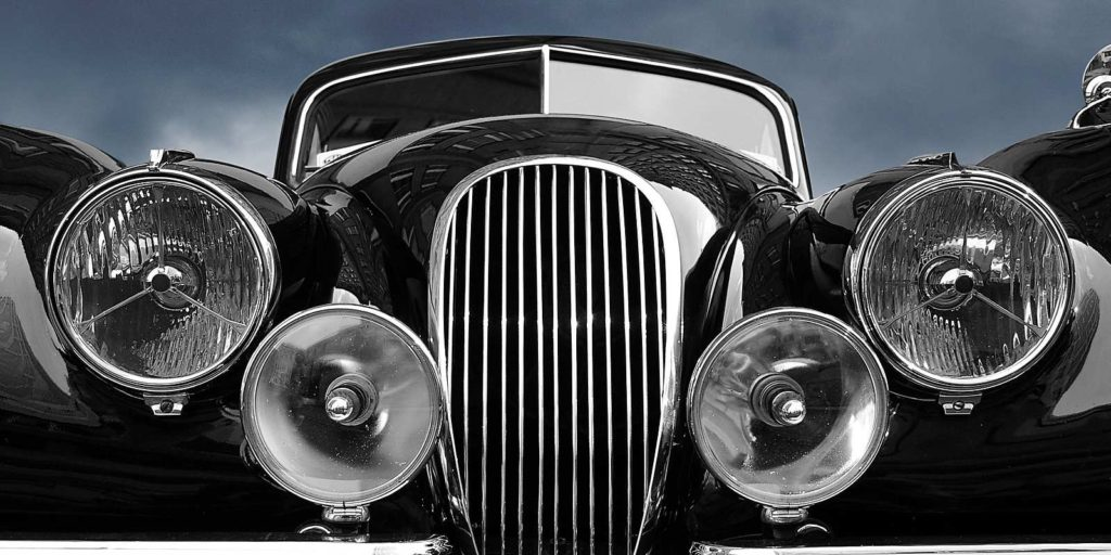 A restored Vintage car. Custom auto body shop can help with your car restoration
