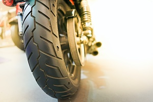 Wheel of a motorcycle in a garage