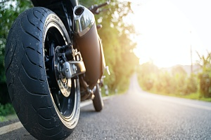 a close up of a wheel on a custom motorcycle