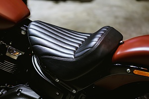 a red motorcycle with a custom seat