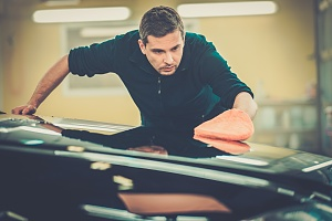 a man working on a car roof