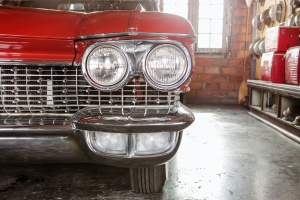 a red car head lights with Car Restoration done