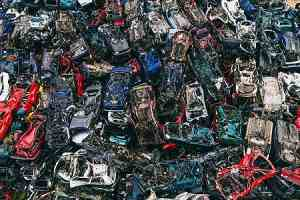 Pile of scrapped cars. Safety regulations for classic car restorations concept