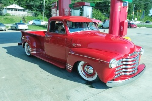 a red truck that has a truck restoration done