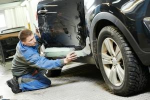 man working on a classic car restoration