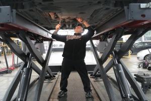 LS Engine Swap being done on a car in garage