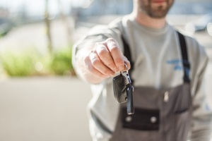 person handing over key after car had ls engine swap