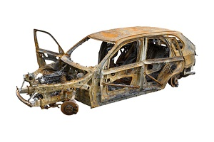 Burnt Out Car Isolated On White Background needing repairing a rusted auto frame