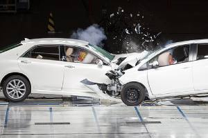 Car collision during a crash test. Such collision can crack or bend the frame
