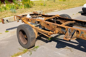 old rusty truck frame with shock absorber needing a truck frame repair