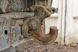 rusted tow hitch attached needing truck frame repair