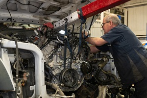 diesel engine being installed into a truck