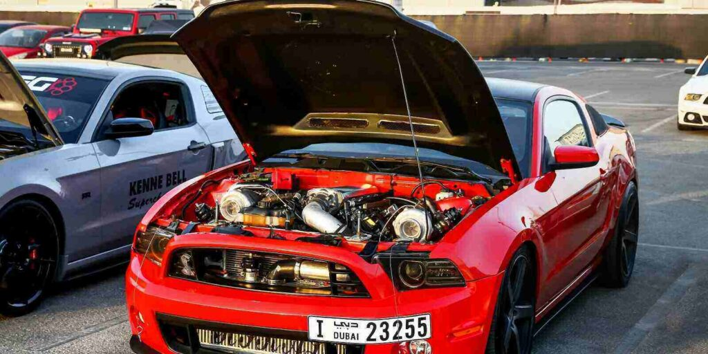 red muscle car ford mustang takes part in the annual gulf car festival